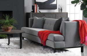 modern contemporary room loft precedent gray sofa with red drape