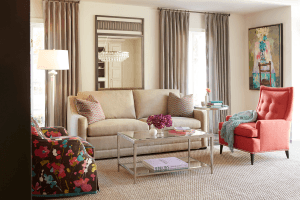 jessica charles living room peach and beige sofa and armchair with white lamp and curtains