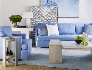 living room chaddock coastal furniture blue sofas with abstract art and white lamp and table