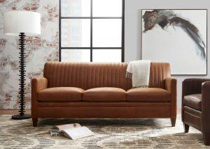 bradington young minimal living room with white lamp and brown sofa