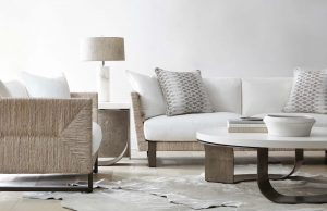 bernhardt interiors living room with beige and white color palette, sofas, lamp, and coffee table